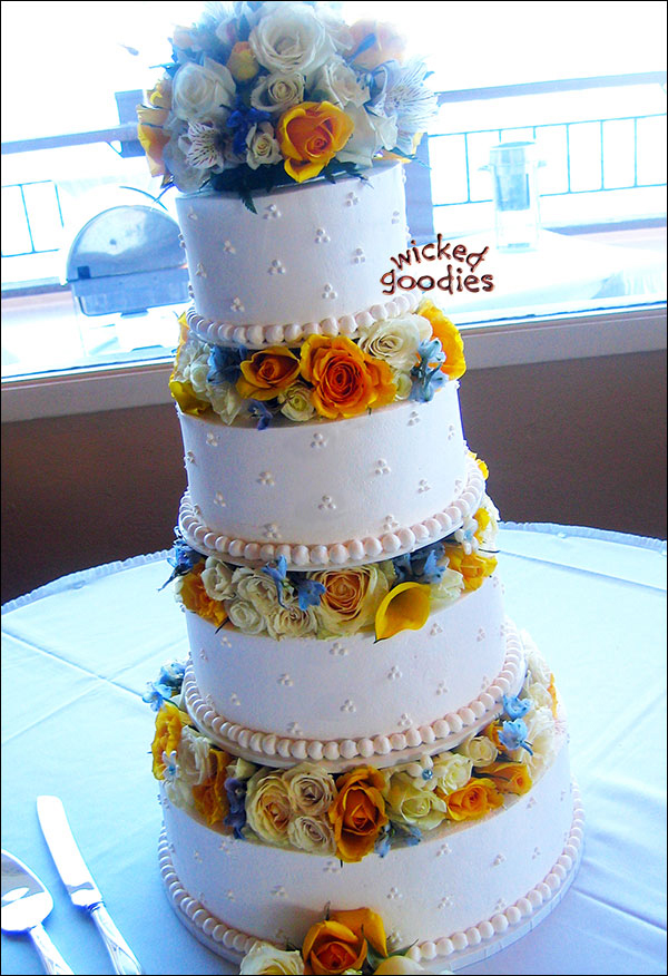Fresh Flowers Between Tiers Wedding Cake