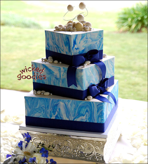 Square three tier wedding cake with blue marbled modeling chocolate