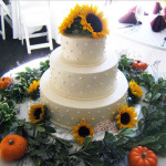 White Wedding Cake with Sunflowers